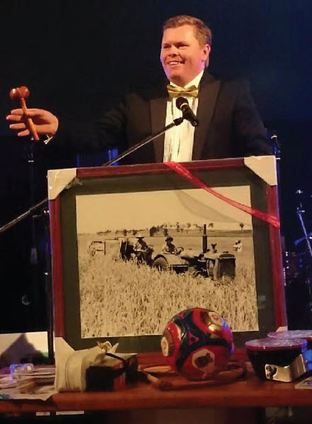 Auctioneer, Damien Crump in full flight at last year's Unleash the Black Dog ball.