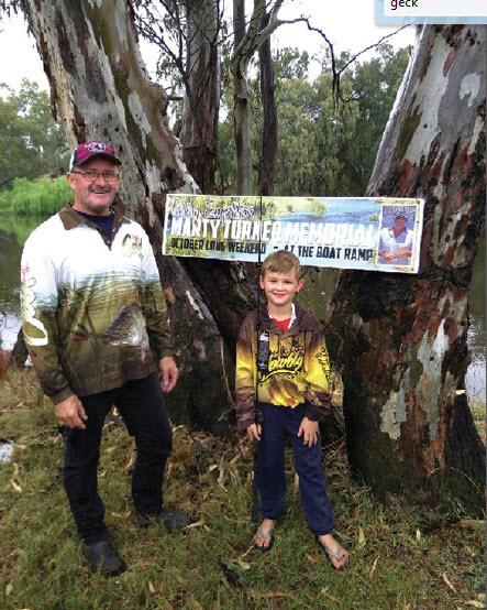 Anglers Club President, Stuart Lanagan, with young angler, Connor Misson.