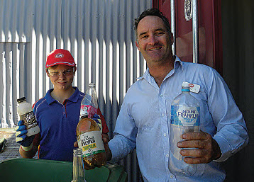 Seth Keam and John Bishton show what type of containers are eligible for the Return and Earn container deposit scheme.