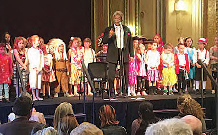 Kamahl performing with Bingara Central School students.