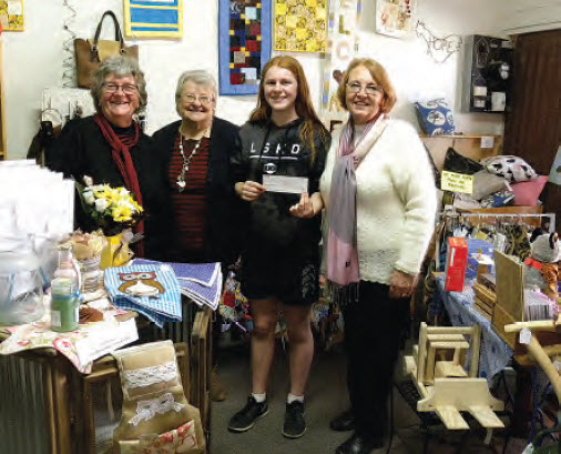 Sarah Heaton receiving a cheque from Bingara Wattle directors, Helen Cornish, Lyn Crawford and Gail List.