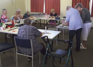 Card makers hard at work: Barb Leech shared her knowledge with very keen participants at the Bingara U3A workshop last Thursday.