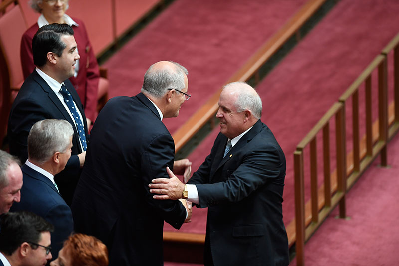 Senator John Williams being congratulated by Prime Minister Scott Morrison
