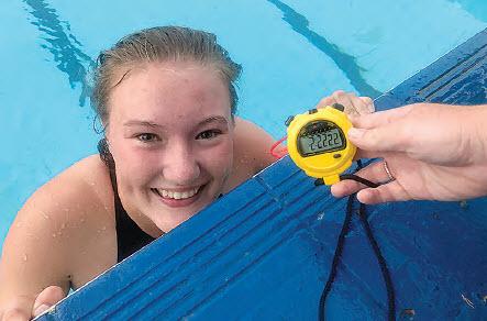 Erica Dixon sets swimming records