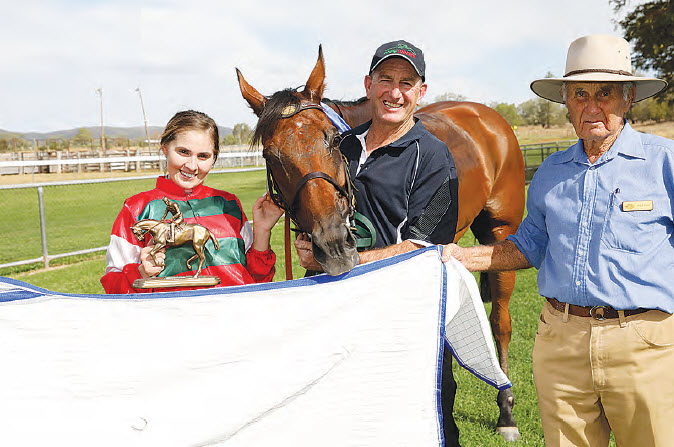 Jockey, Grace Willoughby, and trainer, Craig Martin, with the winner of the MGA Insurance Group Bingara Cup, Present Sense, with Bingara Jockey Club Patron, Doug Withers, who presented the trophy.