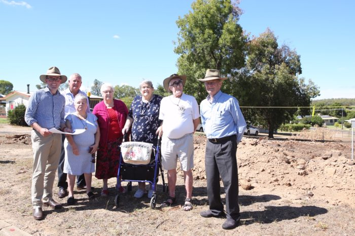Northern Tablelands MP Adam Marshall, left, Gwydir Shire Mayor John Coulton and Naroo Aged Care Hostel residents, Julie Selby, Jean Williams, Joyce Mclymont, Brian Staunton and Doug Wilson in front of where the new all-abilities park will be constructed.
