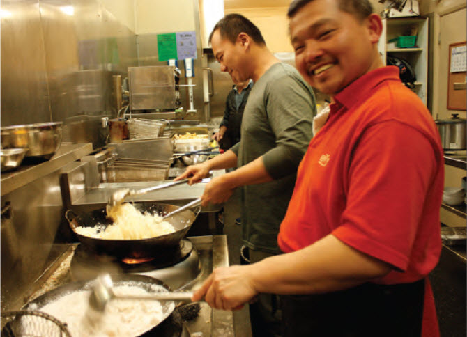 New chefs at the Bingara RSL Club's Gwydir Lily restaurant, A.K. and Terry in action with their woks.