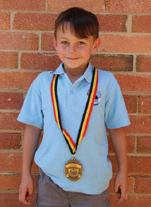 Luka Barac proudly wearing his Medal of Excellence.
