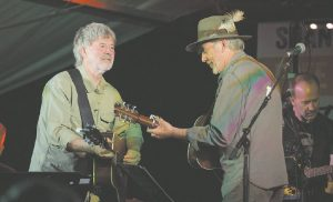 John Schumann and Shane Howard on stage at the 'Concert for the Farmers' at Gwydir Oval, Bingara, last Thursday night.